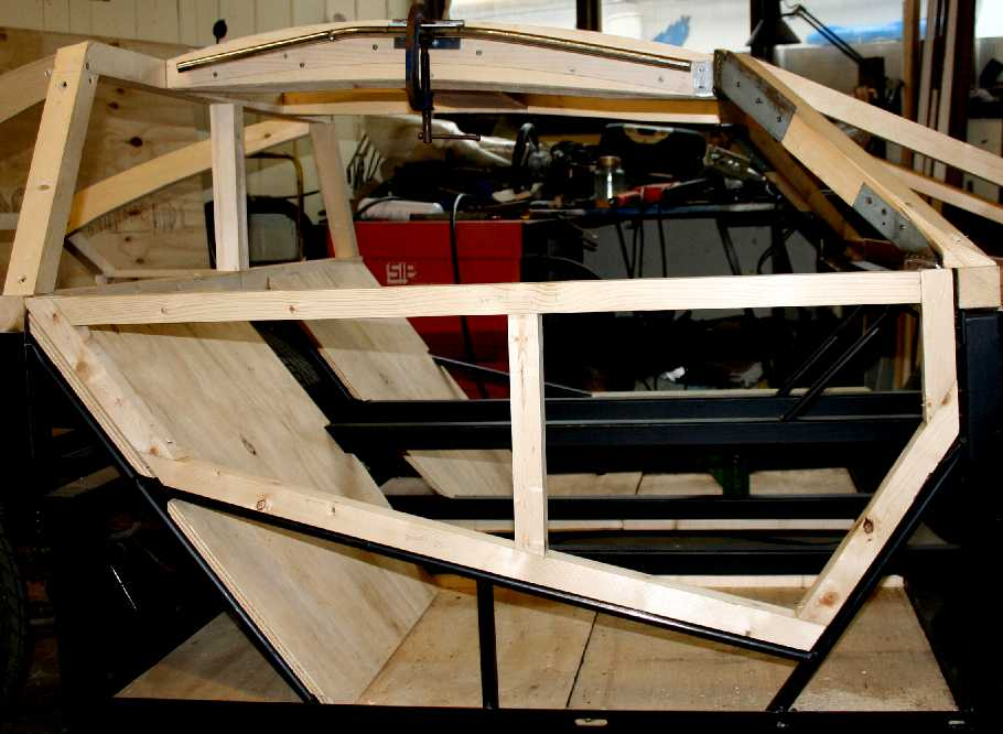 Steel Framed Cars : Gullwing door hinges hinged to the roof at top