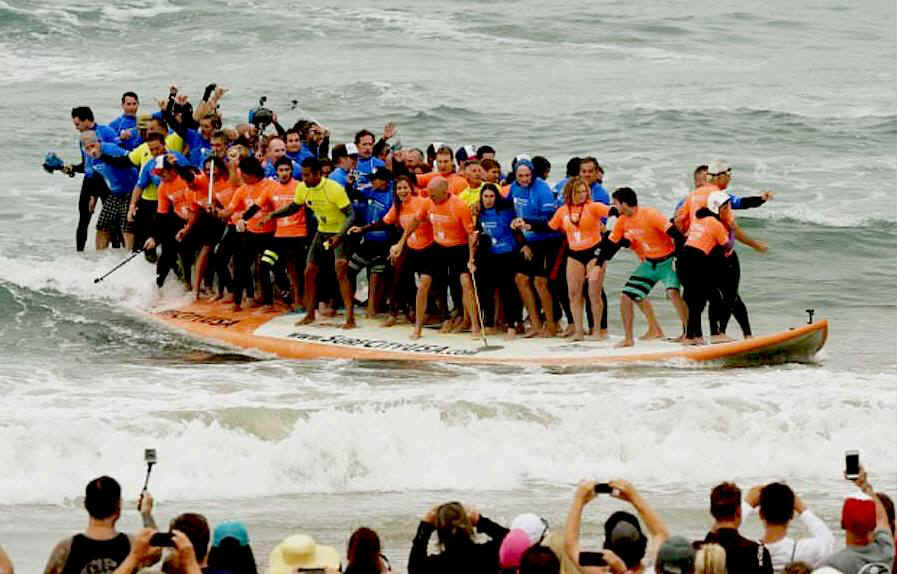 66 surfers in California set a new world record on a giant board
