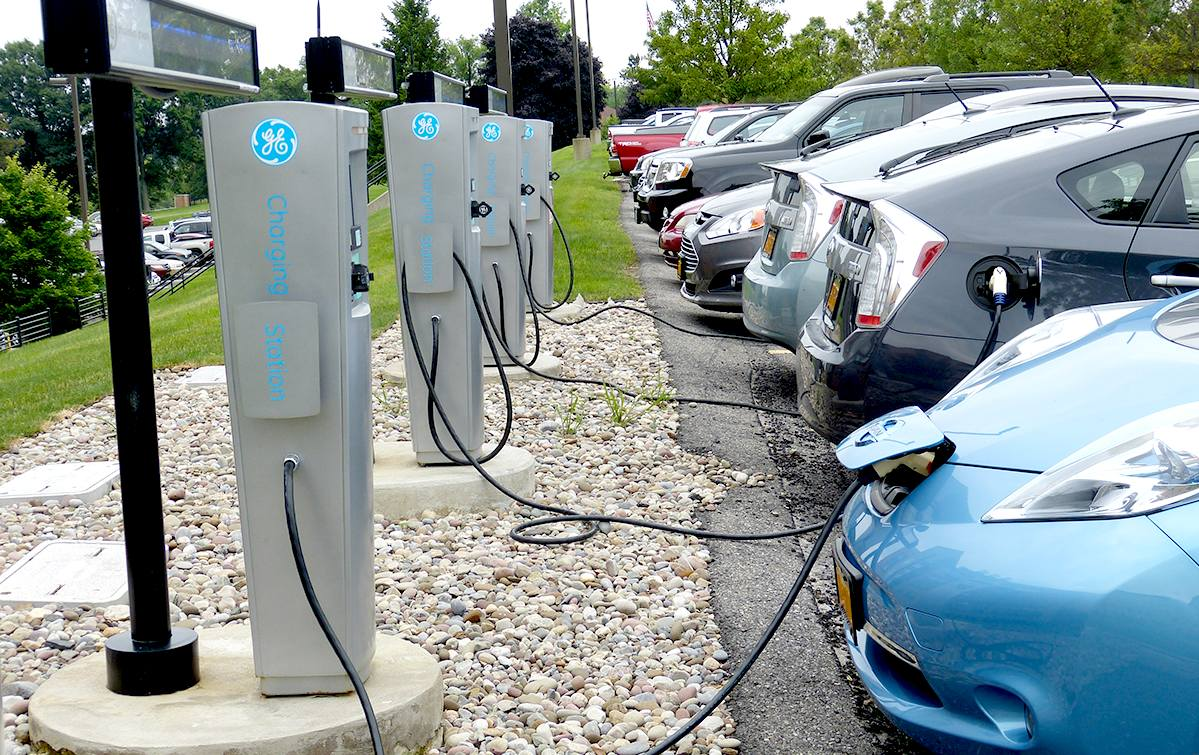 Park and charge plug in bays for electric vehicles